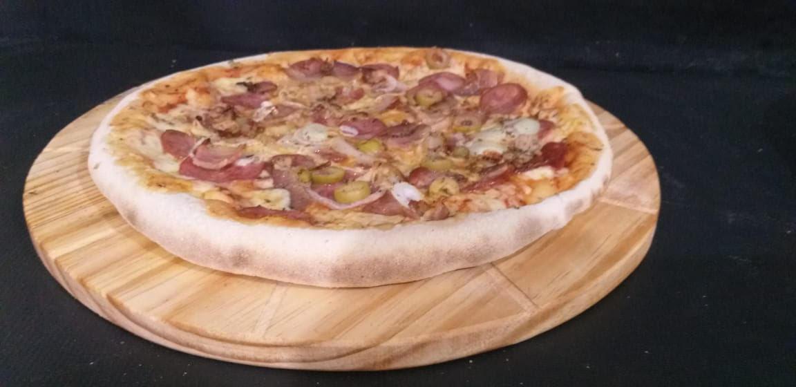 1 Pizza Grande da Linha Tradicional por apenas R$19,90